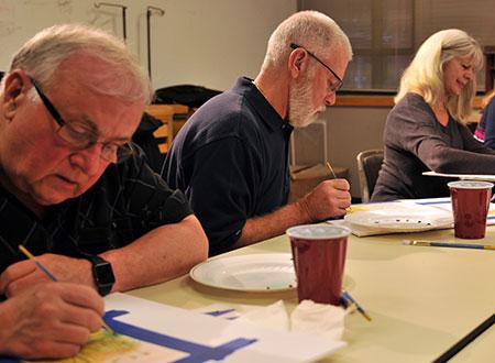 Several seniors painting