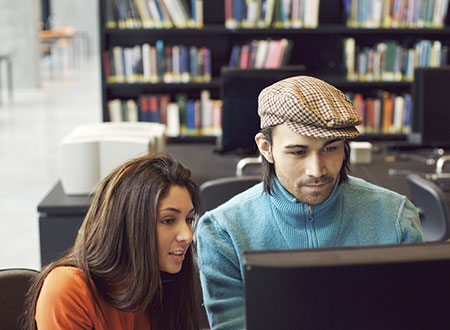 Two teenage students at a computer