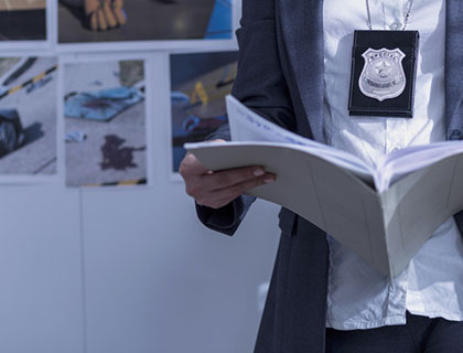 Officer looking at case files