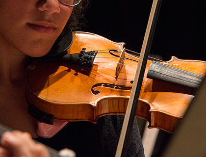 Female musician playing a violin